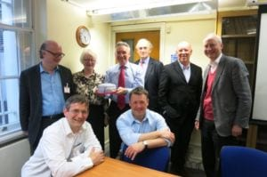 Trustees with Purple Day cake