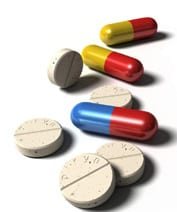 Three capsules and five tablets on a white surface. Ref: www.dreamstime.com