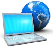 A laptop and globe signifying global communication. Ref: www.dreamstime.com